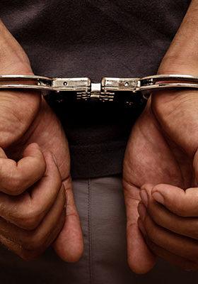 In handcuffs